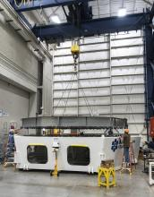 Lowering the simulator onto the test cell, June 2020.